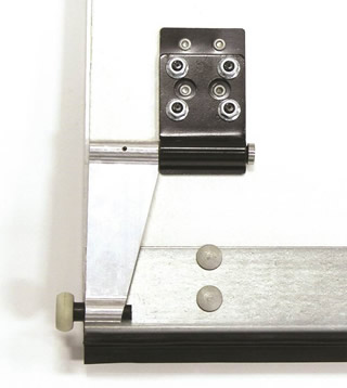 This exceptionally designed bottom roller holder allows an open roll-up door to tuck up under the header. This higher open position provides several ...